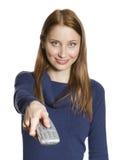Γυναίκα με τον τηλεχειρισμό Στοκ Εικόνες