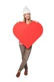 Γυναίκα με το έμβλημα καρδιών Στοκ εικόνες με δικαίωμα ελεύθερης χρήσης