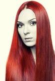 Γυναίκα με το μακρύ κόκκινο τρίχωμα Στοκ Εικόνες