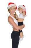 Γυναίκα με το μωρό στον ιματισμό για την ικανότητα και Santa Στοκ εικόνα με δικαίωμα ελεύθερης χρήσης