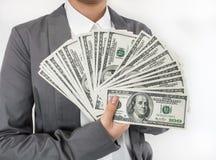 Γυναίκα που διαδίδεται επιχειρησιακή των χρημάτων (U.S.Dollars) Στοκ Εικόνα
