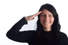 Γυναίκα που κάνει στρατιωτικούς να χαιρετήσουν στοκ εικόνα