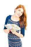 γυναίκα που κρατά έναν ανεμιστήρα των χρημάτων Στοκ φωτογραφία με δικαίωμα ελεύθερης χρήσης