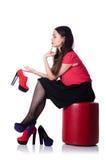 Γυναίκα που δοκιμάζει τα νέα παπούτσια που απομονώνονται Στοκ Εικόνα