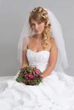 Γυναίκα που φορά το γαμήλιο φόρεμα. Νύφη Στοκ Εικόνα
