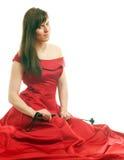Γυναίκα σε ένα φόρεμα που κρατά ένα μαστίγιο ιππασίας Στοκ Εικόνα
