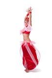 Γυναίκα στην αναδρομική περιστροφή κοστουμιών χορού κοιλιών στοκ φωτογραφία