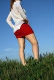Γυναίκα στην κόκκινη φούστα Στοκ Εικόνες
