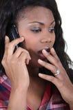 Γυναίκα στον κλονισμό στο τηλέφωνο στοκ εικόνα