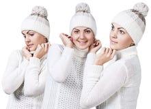 Γυναίκα στο άσπρα πουλόβερ και το καπέλο Στοκ Εικόνες