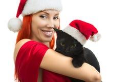 Γυναίκα στο καπέλο Άγιου Βασίλη με τη γάτα Santa - χαριτωμένη γάτα Χριστουγέννων, CH Στοκ Εικόνες