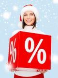 Γυναίκα στο καπέλο αρωγών santa με το σημάδι τοις εκατό Στοκ Εικόνες