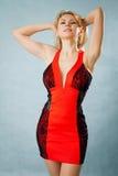 Γυναίκα στο κόκκινο φόρεμα Στοκ Φωτογραφία