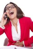 Γυναίκα στο χαμόγελο γραφείων τηλεφωνικής εργασίας Στοκ εικόνες με δικαίωμα ελεύθερης χρήσης