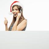 Γυναίκα τηλεφωνικών κέντρων χειριστών, καπέλο Santa Χριστουγέννων Στοκ Φωτογραφία