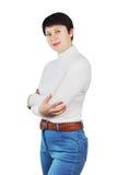 Γυναίκα που φορά το τζιν παντελόνι και άσπρο Turtleneck Στοκ Εικόνες