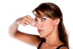 γυναίκα τσιμπήματος μύτης Στοκ εικόνα με δικαίωμα ελεύθερης χρήσης