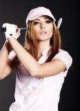 γυναίκα φορέων γκολφ Στοκ Φωτογραφίες