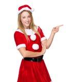 Γυναίκα Χριστουγέννων με το σημείο δάχτυλων κατά μέρος Στοκ φωτογραφίες με δικαίωμα ελεύθερης χρήσης