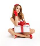 Γυναίκα Χριστουγέννων με το δώρο Στοκ εικόνα με δικαίωμα ελεύθερης χρήσης