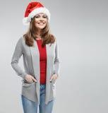 Γυναίκα Χριστουγέννων, πορτρέτο κοριτσιών Santa κόκκινο santa καπέλων Στοκ Εικόνα