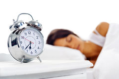 γυναίκα ύπνου ρολογιών Στοκ Εικόνα