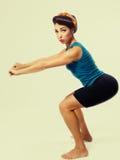 Γυναίκα crouches στοκ εικόνες