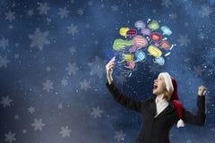 Γυναίκα Santa με το κινητό τηλέφωνο Στοκ Εικόνες