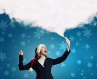 Γυναίκα Santa με το κινητό τηλέφωνο Στοκ εικόνες με δικαίωμα ελεύθερης χρήσης