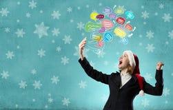 Γυναίκα Santa με το κινητό τηλέφωνο Στοκ Φωτογραφία