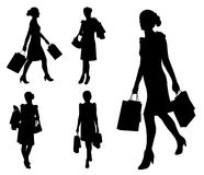 Γυναίκες με τις τσάντες αγορών Στοκ Φωτογραφία