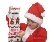 γυναικεία κάλτσα Χριστουγέννων αγοριών Στοκ Φωτογραφία