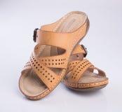 γυναικεία παπούτσια παπουτσιών ή ύφους σε ένα υπόβαθρο Στοκ Φωτογραφίες