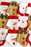 Γυναικείες κάλτσες Χριστουγέννων για τα δώρα Στοκ φωτογραφίες με δικαίωμα ελεύθερης χρήσης
