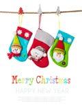 Γυναικείες κάλτσες Χριστουγέννων που απομονώνονται στο λευκό Στοκ Φωτογραφίες
