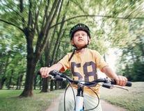 Γύρος αγοριών το ποδήλατό του Στοκ Εικόνες