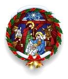Γύρω από λεκιασμένο γυαλί με τη σκηνή Χριστουγέννων στο στεφάνι ελαιόπρινου Στοκ φωτογραφία με δικαίωμα ελεύθερης χρήσης