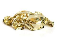 Γλυκά σοκολάτας στο χρυσό φύλλο αλουμινίου Στοκ εικόνα με δικαίωμα ελεύθερης χρήσης