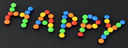 Γλυκά bonbons με τον ΕΥΤΥΧΗ τίτλο Στοκ φωτογραφία με δικαίωμα ελεύθερης χρήσης