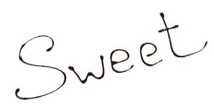 Γλυκιά λειωμένη επιγραφή σοκολάτα Στοκ Εικόνες