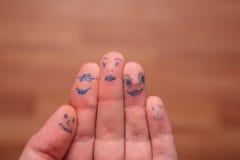 δάχτυλα προσώπων που χρωμ& Στοκ Φωτογραφία