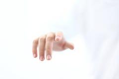 δάχτυλο κουμπιών σχετικά Στοκ Φωτογραφία