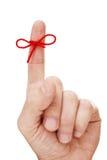 Δάχτυλο με το δεμένο τόξο στοκ εικόνα με δικαίωμα ελεύθερης χρήσης