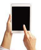 Δάχτυλο που δείχνει στην οθόνη του PC ταμπλετών Στοκ Εικόνες