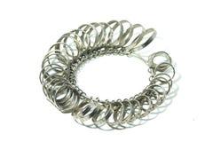 Δάχτυλο Jeweler που ταξινομεί τα εργαλεία που απομονώνονται στο λευκό Στοκ Εικόνα
