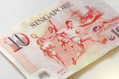 Δέκα δολάρια της Σιγκαπούρης με μια σημείωση 10 δολάρια Στοκ Εικόνες