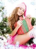 δέντρο santa αρωγών κοριτσιών δώρων Χριστουγέννων κιβωτίων Στοκ Εικόνες