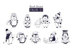 Δέσμη του αγοράκι και του κοριτσιού penguins που φορούν το χειμερινό ιματισμό και καπέλα που σύρονται στα μονοχρωματικά χρώματα Σ απεικόνιση αποθεμάτων