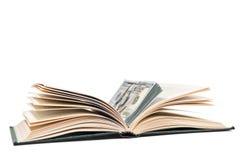 Δέσμη των χρημάτων στο βιβλίο στοκ εικόνες με δικαίωμα ελεύθερης χρήσης