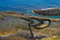 Δίδυμο Weir πετρών καρδιών (Chimei, Penghu, Ταϊβάν) Στοκ φωτογραφία με δικαίωμα ελεύθερης χρήσης
